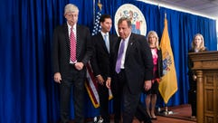 New Jersey Gov. Chris Christie, center, walks from