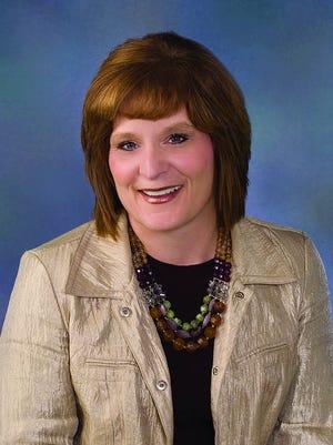 Robin Waddle, Pratt, has earned a top service award from American Family Insurance.