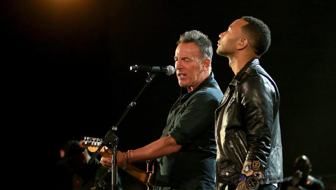 Bruce Springsteen, left, and John Legend opened Wednesday's 'Shining a Light' concert in Los Angeles.