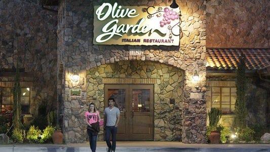 Patrons exit an Olive Garden, a Darden restaurant brand, in Short Pump, Va., May 22, 2014.