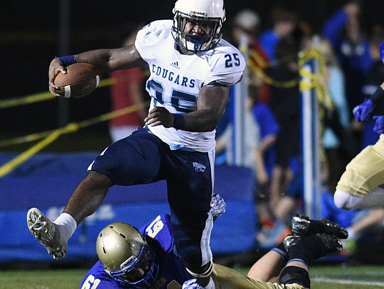 Centennial running back Tyrel Dodson escapes from Brentwood's Will Arsta.