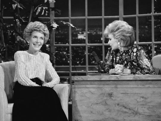 """In this Oct. 30, 1986 file photo, talk show host Joan Rivers, right, talks with guest, first lady Nancy Reagan, during her appearance on """"The Late Show Starring Joan Rivers,"""" in Los Angeles. Rivers, the raucous, acid-tongued comedian who crashed the male-dominated realm of late-night talk shows and turned Hollywood red carpets into danger zones for badly dressed celebrities, died Thursday, Sept. 4, 2014. She was 81. Rivers was hospitalized Aug. 28, after going into cardiac arrest at a doctor's office."""