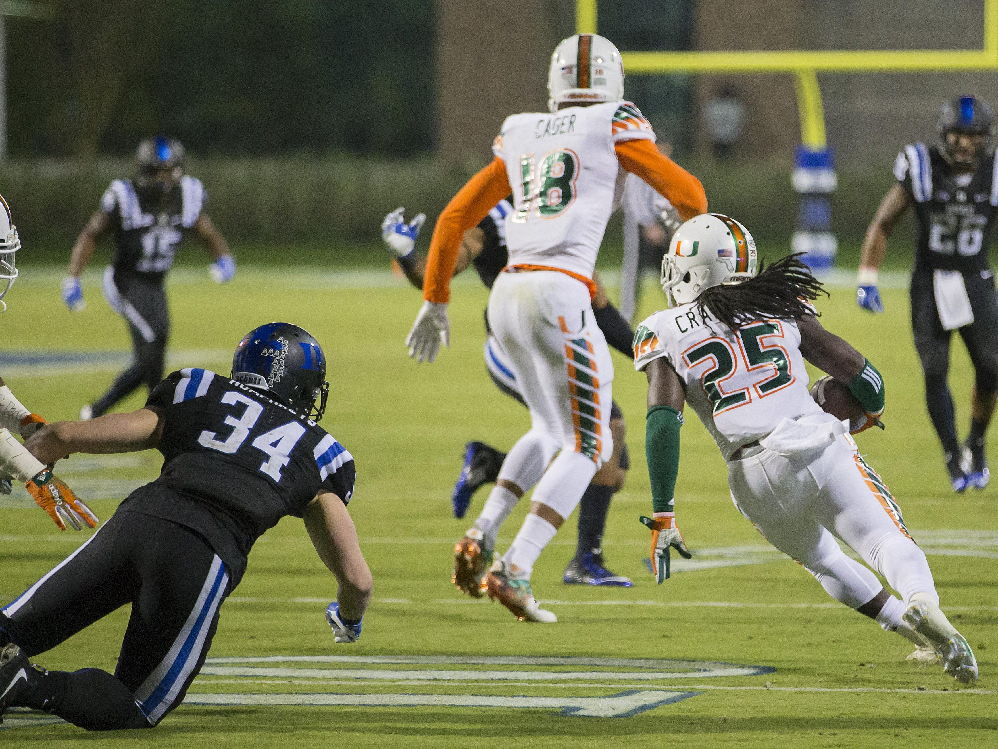 Miami's Dallas Crawford (25) returns a kickoff, which featured multiple laterals before Corn Elder subsequently received the final lateral, and scored to beat Duke 30-27 in an NCAA college football game, in Durham, N.C., Saturday, Oct. 31, 2015. (AP Photo/Rob Brown)