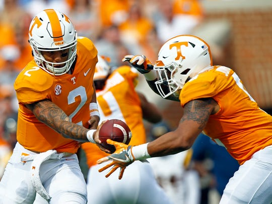 FILE- In this Saturday, Sept. 8, 2018, file photo, Tennessee quarterback Jarrett Guarantano (2) hands the ball off to running back Tim Jordan (9) during the first half of an NCAA college football game against East Tennessee State University in Knoxville, Tenn. While Guarantano has started Tennessee's first two games at quarterback after beating out Stanford graduate transfer Keller Chryst in the preseason, Tennessee has continued experimenting on the offensive line and running back. (AP Photo/Wade Payne, File)