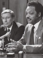Gov. Evan Mecham (left) sits with civil-rights activist