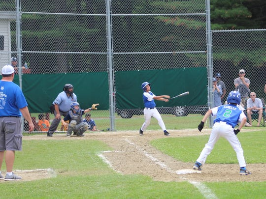 Carter Beaupre watches his home run during Saturday's 11-12-year-old District I Little League championship game.