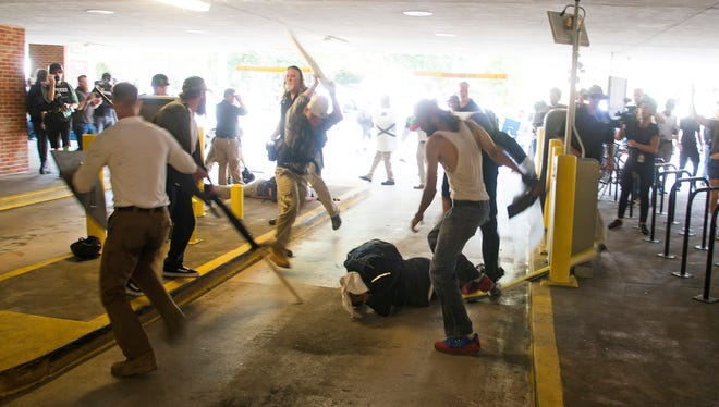 On Saturday, Aug. 12, 2017, DeAndre Harris is assaulted in a parking garage beside the Charlottesville police station after a white nationalist rally was disbursed by police, in Charlottesville, Va. Vonz Long helped Harris directly following the assault.