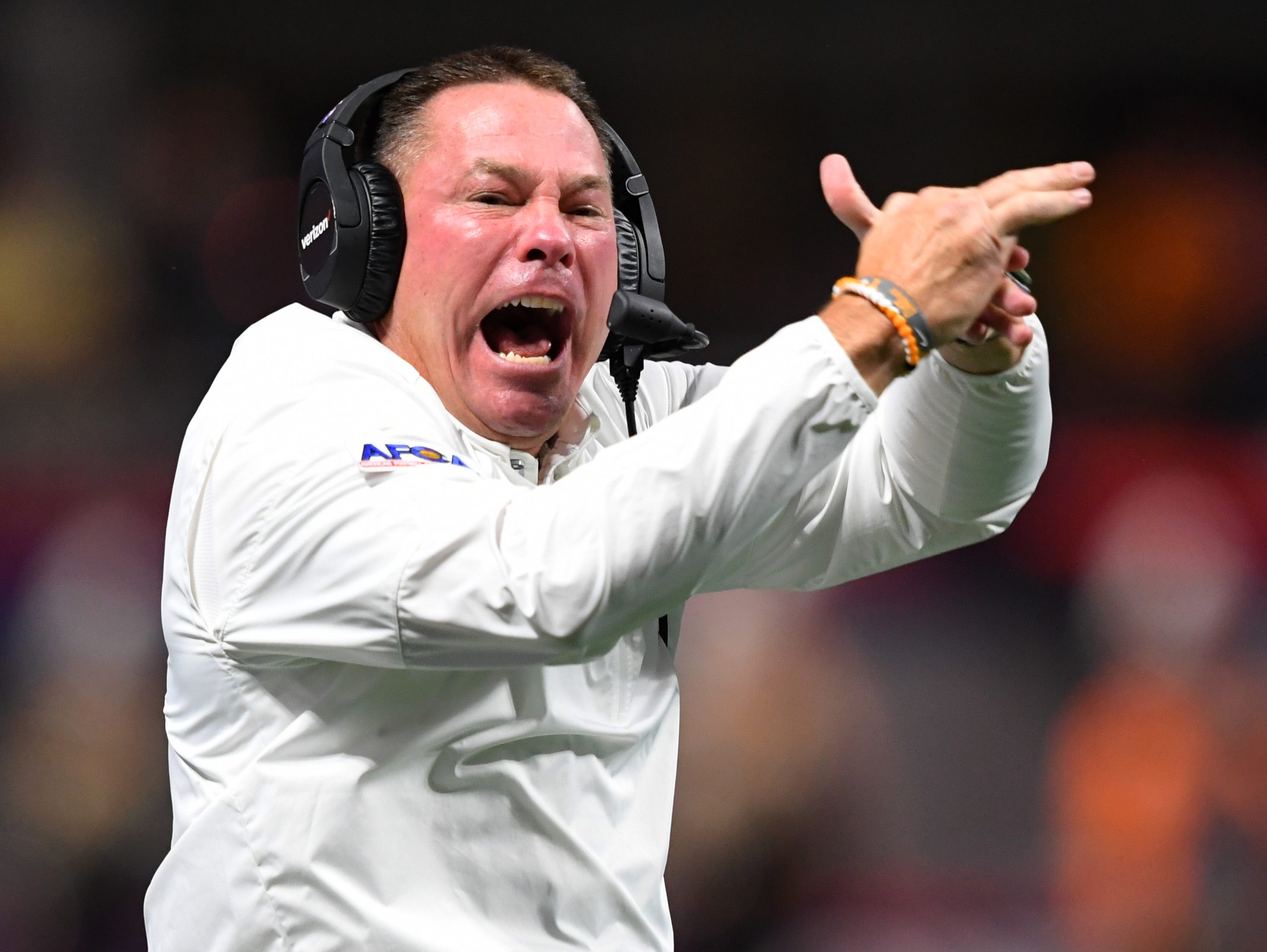 Tennessee Volunteers head coach Butch Jones tries to call a time out against the Georgia Tech Yellow Jackets during the second quarter at Mercedes-Benz Stadium in Atlanta.