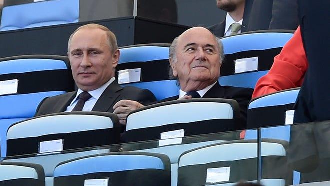Russian president Vladimir Putin with FIFA president Sepp Blatter at the 2014 World Cup final in Rio de Janeiro.