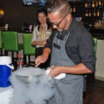 Chef Garrett Welch creates a Liquid Nitrogen Sake Rocks dressing during Suzy's Secret Supper on May 24 at the Red Ginger in the Melbourne Square Mall.  Brian Curl/for FLORIDA