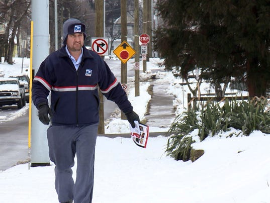 Usps worker donald defreese treks through snow and ice to deliver mail
