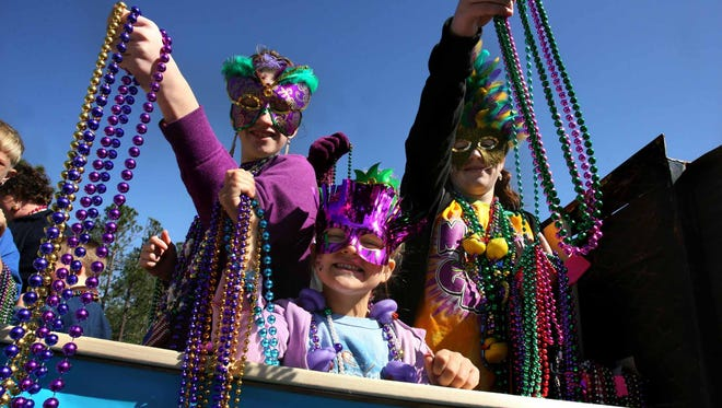 Beads are thrown to parade goers during a Gulf Coast Mardi Gras parade in 2006.