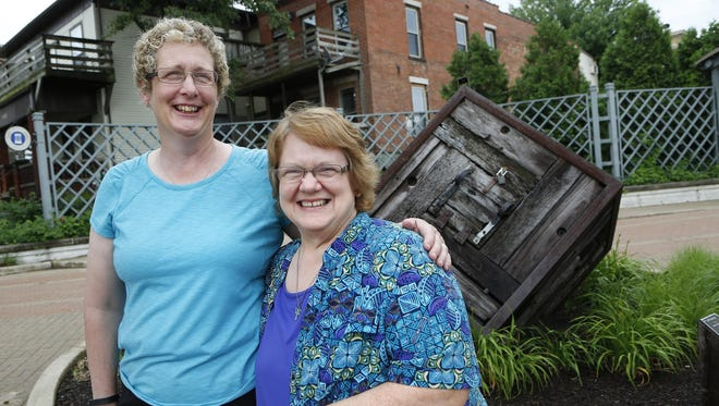Joyce and Anita Sanford Friday, June 19, 2015, in downtown Lafayette. The same-sex couple married last October. In upcoming weeks, the Supreme Court will decide the fate of same-sex marriages.
