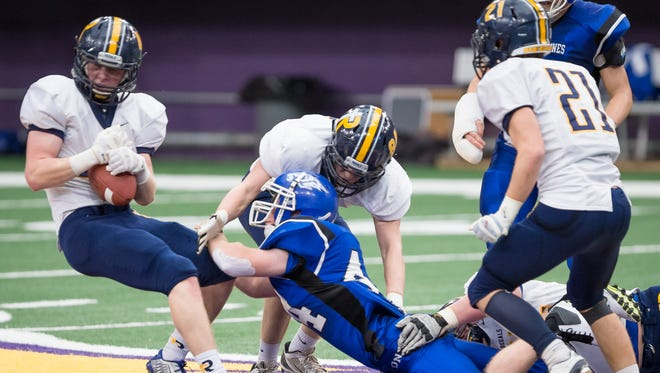 Iowa City Regina linebacker Isaac Vollstedt (44) strips the ball from Dike-New Hartford running back Trent Johnson (44) in the second quarter at the UNI-Dome in Cedar Falls Saturday.