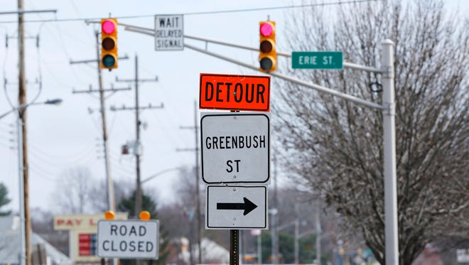 A detour directs traffic eastbound on Greenbush Street onto Erie Street Tuesday, March 15, 2016, in Lafayette. The city plans to move forward with the repaving of Greenbush Street and will also bring a new traffic signal and sidewalk from Erie Street to Elmwood Avenue.