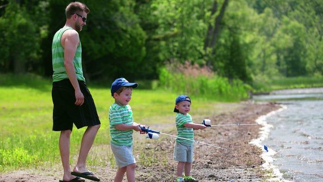 Chris, Ethan, 3, and Luke Sobolewski, 2, left to right, go fishing at Mendon Ponds Park.