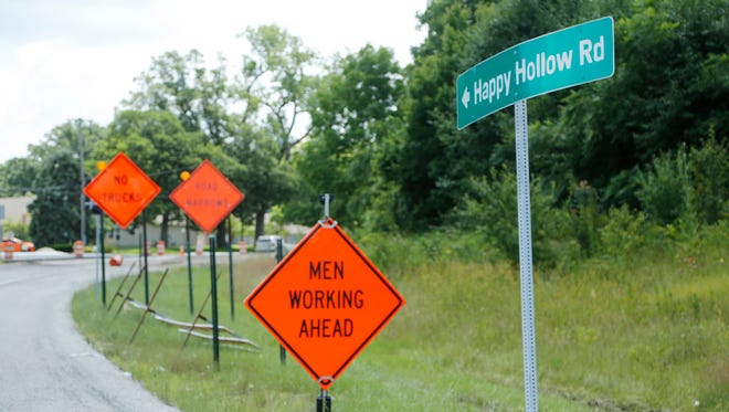 Numerous warning signs greet motorists at the intersection of Soldiers Home Road and Happy Hollow Road Tuesday, July 19, 2016, in West Lafayette. The City of West Lafayette is considering changing rules for semitrailer traffic, with certain exceptions, through residential areas.