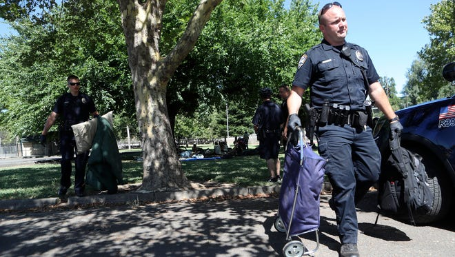 Redding police remove evidence after a stabbing Wednesday morning at South City Park.