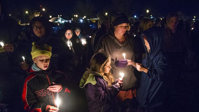 A candlelight vigil was held at a park in Aztec, New Mexico at 6 pm, Thursday, December 7, 2017, after three people were shot to death at the local high school.