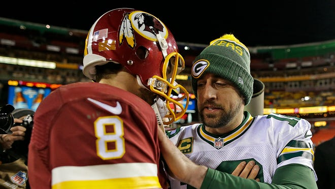 Green Bay Packers quarterback Aaron Rodgers is congratulated by Washington quarterback Kirk Cousins after their NFC wild-card round playoff game at FedEx Field in Landover, Md., in January of 2016.