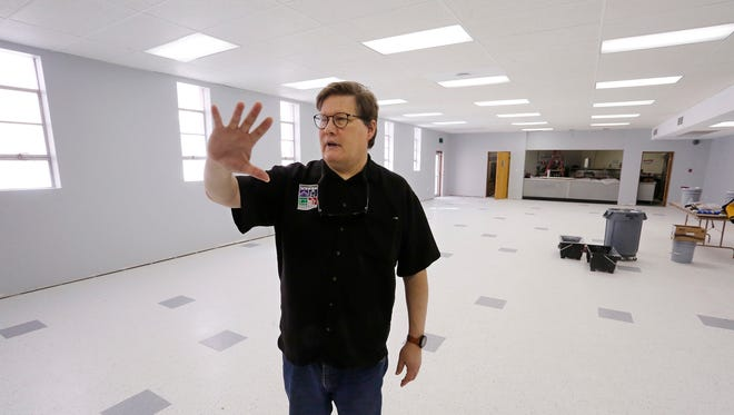 Craig Hadley, executive director of Tippecanoe County Historical Association (TCHA), talks about the banquet room Thursday, April 12, 2018, inside the former Masonic Temple at the corner of Sixth and Columbia streets in downtown Lafayette. The TCHA purchased the building in January of 2017. The TCHA is renovating the building and will offer it as an event venue and also ues it for curatorial space.