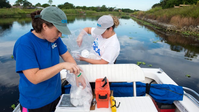 """""""(We're) looking to identify the biggest problem areas within the C-24 Canal,"""" said Chloe Lloyd (left), a research associate with the Ocean Research & Conservation Association, as she and Retta Rohm, ORCA research assistant, collect water and sediment samples and deploy muck traps on Sept. 29, 2016, on the waterway in Port St. Lucie. The samples will be analyzed to determine which nutrients are most prevalent in the muck."""