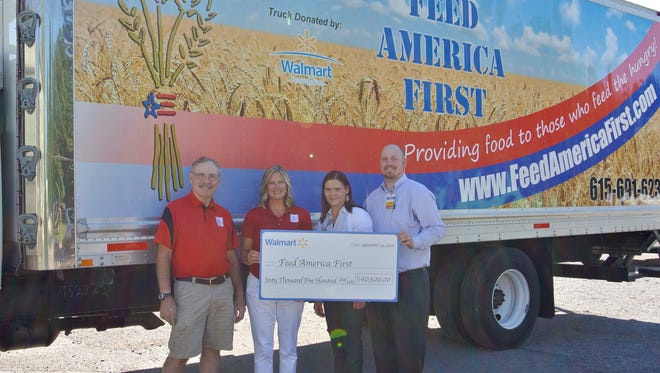 Feed America First of Tennessee received a $60,500 grant from the Walmart Foundation's State Giving Program to purchase a food distribution truck. Specifically, this grant will positively impact the local community by expanding and sustaining food distribution to feed those in need in Middle Tennessee. Pictured Here: Walmart Assistant Manager Brian Aten presents Feed America First representatives with Walmart grant check.