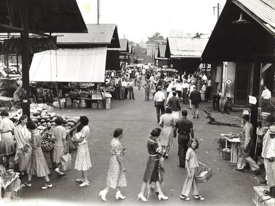 A 1943 photo shows the Haymarket bustling with customers.