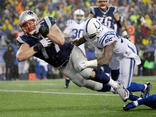 New England Patriots tackle Nate Solder scores against Indianapolis Colts inside linebacker D'Qwell Jackson (52) on a 16-yard touchdown pass from quarterback Tom Brady Sunday.