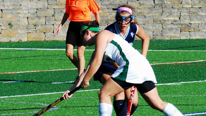 Ursuline Academy's Jillian Shive, front, was voted Enquirer Preps Ohio Athlete of the Week for Oct. 18-24