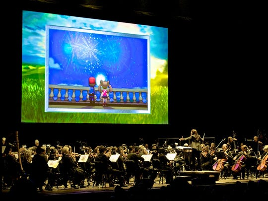 "Conductor Susie Seiter leads the Chamber Orchestra of Philadelphia at the Mann Center in Philadelphia in 2014 for ""Pokémon: Symphonic Evolutions."" The show comes to the PNC Bank Arts Center in Holmdel on Aug. 20."