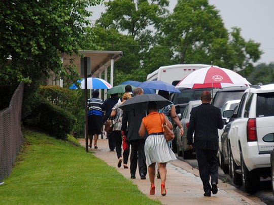 Mourners braved an afternoon rain to attend the funeral