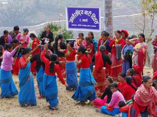 Women wearing blue saris to celebrate uniqueness at Educate the Children's International Women's Day celebration in 2013 in Nepal.