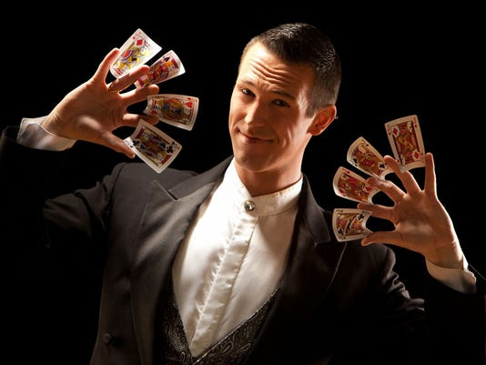 Jason Andrews _cards_in_fingers.jpeg