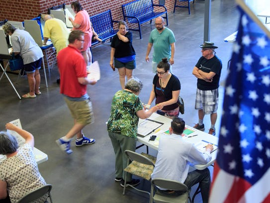 Voters line up to cast a ballot in Iowa primary at