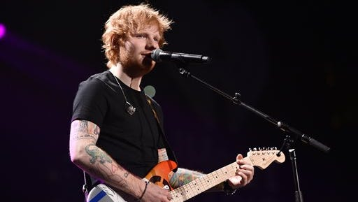 FILE - In this Dec. 5, 2014 file photo, Ed Sheeran performs at the KIIS FM's Jingle Ball at the Staples Center in Los Angeles. Sheeran, Beck, Sam Smith and the Electric Light Orchestra are among a new batch of performers added to the bill for Sunday night's Grammy Awards. The Grammys continue their signature of pairing artists for special one-time performances.  Sheeran will take the stage with Herbie Hancock. (Photo by John Shearer/Invision/AP, File)
