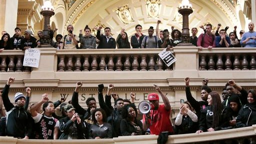 Demonstrators gather  at the State Capitol rotunda to protest the shooting of Tony Robinson  Monday, March 9, 2015, in Madison, Wis. Robinson, 19, was fatally shot Friday night by a police officer who forced his way into an apartment after hearing a disturbance while responding to a call. Police say Robinson had attacked the officer. (AP Photo/Wisconsin State Journal, Michael P. King)