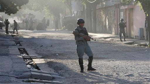 Afghan security officers patrol near a guesthouse targeted in an attack by the Taliban, in Kabul, Afghanistan, Wednesday, May 27, 2015. An all-night siege in an upscale neighborhood of Afghanistan's capital ended in the early hours of Wednesday morning with the deaths of four heavily armed Taliban attackers, though no civilians or security personnel were injured or killed, an Afghan official said. (AP Photo/Allauddin Khan)
