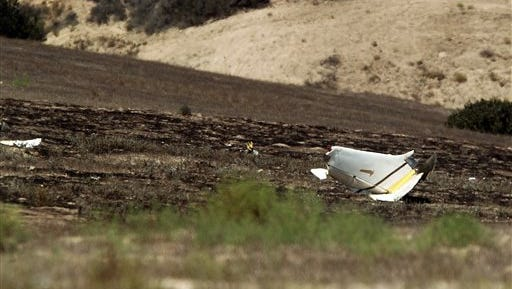 Authorities say multiple people died following the midair collision and crash of two small planes near an airport in southern San Diego County. Federal Aviation Administration spokesman Ian Gregor says the collision occurred around 11 a.m. Sunday, Aug. 16, 2015, about 2 miles northeast of Brown Field Municipal Airport. (John Gastaldo/U-T San Diego via AP)