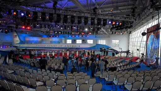 Workers prepare the debate stage set before the CNN Republican presidential debate at the Ronald Reagan Presidential Library on Wednesday, Sept. 16, 2015, in Simi Valley, Calif. (AP Photo/Mark J. Terrill)