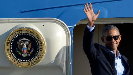 "FILE - In this Oct. 9, 2016 file photo, President Barack Obama, wearing sunglasses, waves while boarding Air Force One before leaving O'Hare International Airport in Chicago. From his campaign fist bump to his theatrical mic drop at the last White House correspondents' dinner, Barack Obama ruled as America's pop culture president. His two terms played out like a running chronicle of the trends of our times: slow-jamming the news with Jimmy Fallon, reading mean tweets with Jimmy Kimmel, filling out his NCAA basketball bracket on ESPN, cruising with Jerry Seinfeld on ""Comedians in Cars Getting Coffee."""