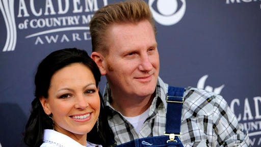 "FILE - In this April 3, 2011, file photo, Joey Martin Feek, left, and husband Rory Lee Feek, of ""Joey + Rory,"" arrive at the Annual Academy of Country Music Awards in Las Vegas.  Joey Feek, who was diagnosed with stage four cancer, told her husband Rory that if they ever got another chance to be nominated, he should attend the ceremony. She died on March 4 at the age of 40, but she got her wish. Joey + Rory are nominated this year for best roots gospel album for their record ""Hymns."""