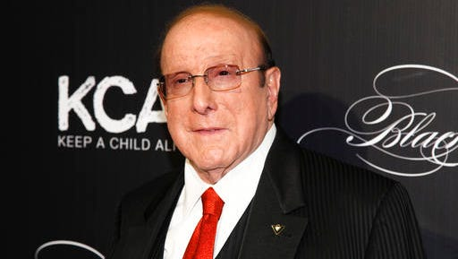 FILE - In this Oct. 19, 2016 file photo, Clive Davis attends Keep a Child Alive's 13th Annual Black Ball at the Hammerstein Ballroom in New York.  Davis isn't letting national politics affect his famed pre-Grammys party. The veteran music executive says his annual event would be at capacity again this year despite moves elsewhere in Hollywood to scale back awards season soirees.