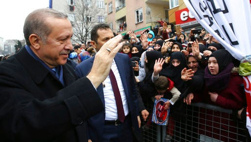 """Turkey's President Recep Tayyip Erdogan salutes his supporters in Istanbul, Saturday, March 11, 2017. Turkey and the Netherlands sharply escalated a dispute between the two NATO allies on Saturday as the Dutch withdrew landing permission for the Turkish foreign minister's aircraft, drawing Turkish President Recep Tayyip Erdogan to call them """"fascists""""."""
