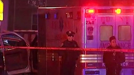 This still image taken from video shows police at the scene where Yadira Arroyo, 44, an emergency medical technician has died after she was run over by a stolen ambulance, Thursday, March 16, 2017, in the Bronx borough of New York.