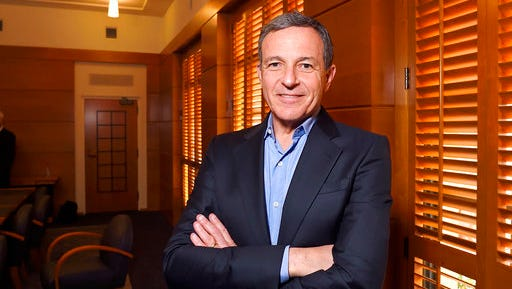 FILE - In this Thursday, Dec. 10, 2015, file photo, Bob Iger, chairman and CEO of The Walt Disney Company, poses in a conference room before speaking to members of the media about bringing NFL football back to the Los Angeles area, in Burbank, Calif. On Thursday, March 23, 2017, The Walt Disney Co. announced that Iger is getting a one-year contract extension, to July 2, 2019.