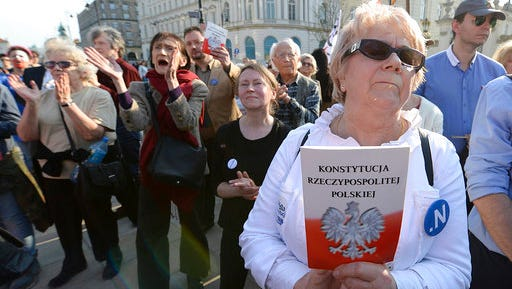 People demonstrate on the 20th anniversary of Poland's constitution in front of the presidential palace in Warsaw, Poland, on Sunday, April 2, 2017. The protest comes at a time that they and other poles fear the constitutional order in Poland is threatened by the country's populist government.