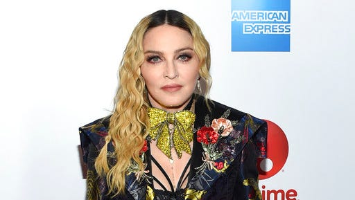 """FILE - This Dec. 9, 2016 file photo shows Madonna at the 11th annual Billboard Women in Music honors in New York. On Monday, the Hollywood Reporter announced that Universal had acquired the rights to """"Blond Ambition,"""" a script about the singer. On Tuesday, Madonna expressed her displeasure via an Instagram post. She said that only she was qualified to tell her story and """"anyone else who tries is a charlatan and a fool."""""""
