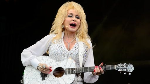 U.S singer Dolly Parton performs at Glastonbury music festival, England, Sunday. Thousands of music fans have arrived for the festival to see headliners Arcade Fire, Metallica and Kasabian.
