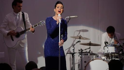 """Singer Katy Perry performs her song """"Roar"""" at an event for the Special Olympics hosted by President Barack Obama in the State Dining Room at the White House in Washington, Thursday."""